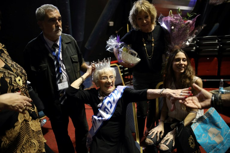 Holocaust survivor Tova Ringer, 93 year old, reacts after winning the annual Holocaust survivors' beauty pageant in in Haifa, Israel October 14, 2018. REUTERS/Corinna Kern
