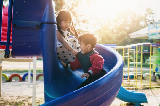 boy and girl on the playground; Shutterstock ID 528652228; Purchase Order: -