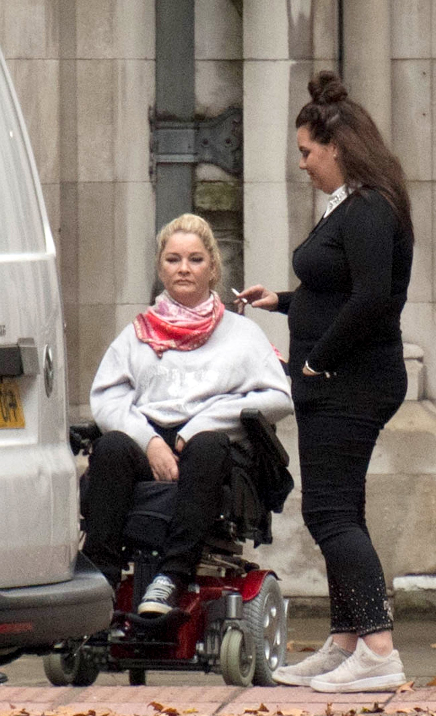Claire Busby, 46, (left), of Maidenhead, Berkshire, outside the High Court in London, where she is suing Berkshire Bed Company, trading as Beds Are Uzzz, for seven-figure damages, after she was left paralysed after being ?catapulted? from her new bed during a sex session. PRESS ASSOCIATION Photo. Picture date: Monday October 15 2018. Ms Busby suffered a serious injury to her spine when she fell from the super king-size double divan as she shifted her position. The 46-year-old claims the bed was in a ?defective state? at the time of her accident. See PA story COURTS Catapulted. Photo credit should read: Stefan Rousseau/PA Wire