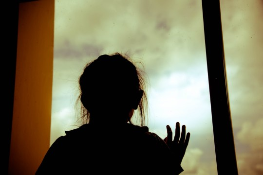 Silhouette sad little girl in room and looking out the window; Shutterstock ID 678890566; Purchase Order: -