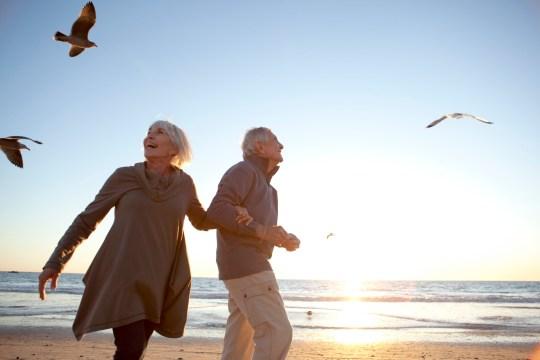 Senior Male and Female Couple Romantic Beach Lifestyle
