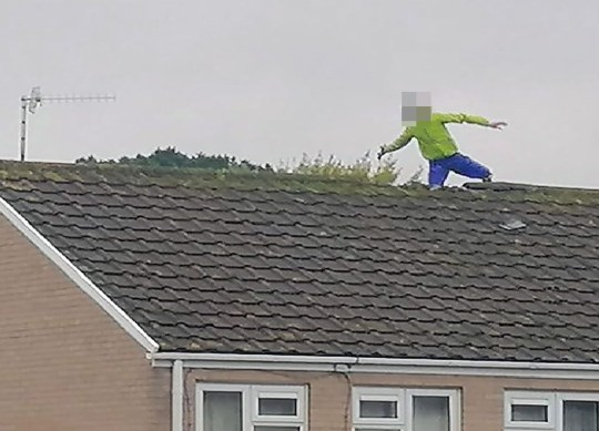 WESSEX NEWS AGENCY Jim Hardy email news@britishnews.co.uk mobile 07501 221880 STORY CATCHLINE: CYCLE A bizarre stand-off between police and a French-speaking man in fluorescent yellow cycling gear and a helmet has entered its second day with him still sitting 50ft up on a West Country rooftop. Pic shows him