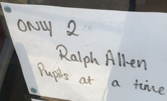 """The sign on the front door of the Co-op in Combe Down, Bath. See SWNS story SWBRshop; A shop in Bath has defended its decision to post a sign at the entrance saying """"only two Ralph Allen students at a time"""" would be allowed into the store.The store manager of the Co-op said it was the decision to put up the sign had been """"made for the right reasons"""". The sign specified that there would be a limit on the number of Ralph Allen students allowed into the store."""