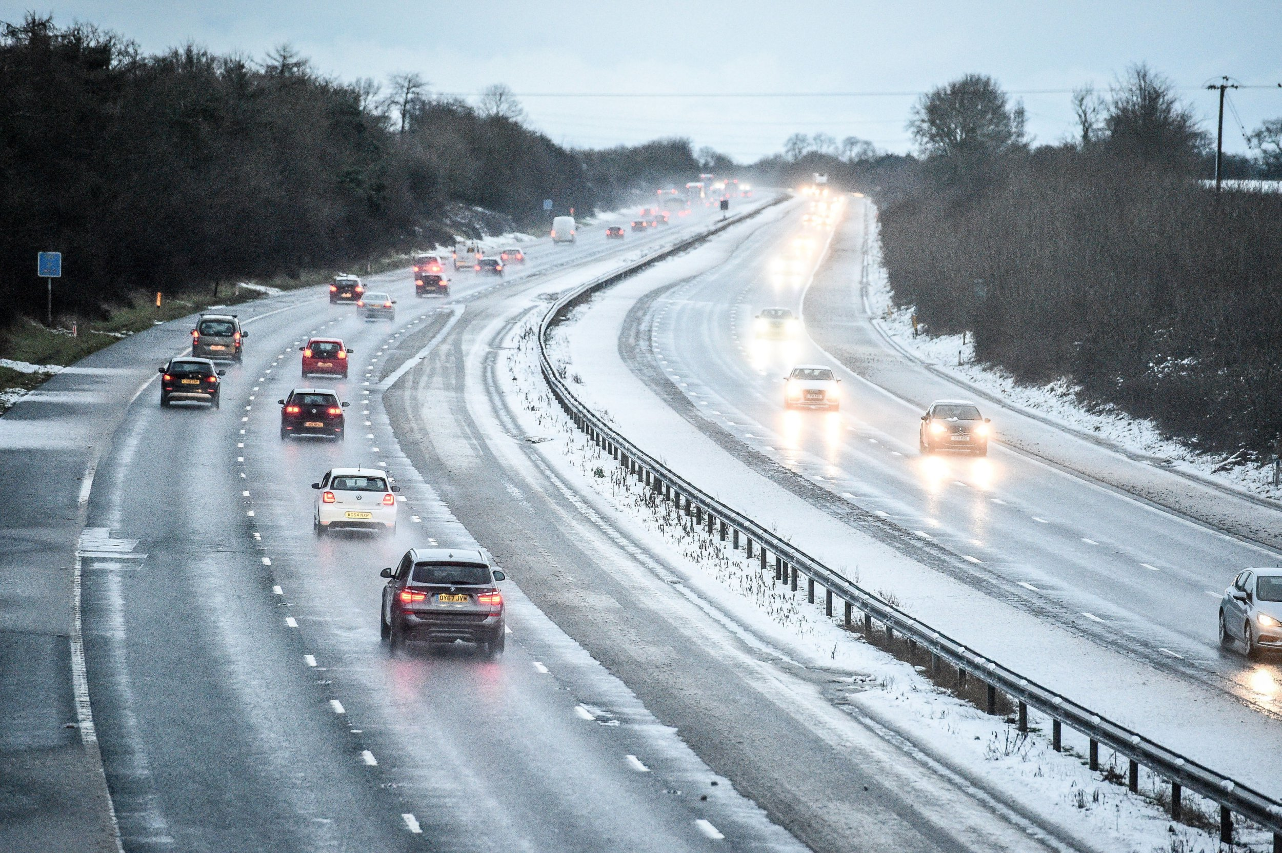 Snow reduces the M5 motorway down to two lanes between junction 14 and 15 in South Gloucestershire after overnight snow has caused travel disruptions across parts of the UK.