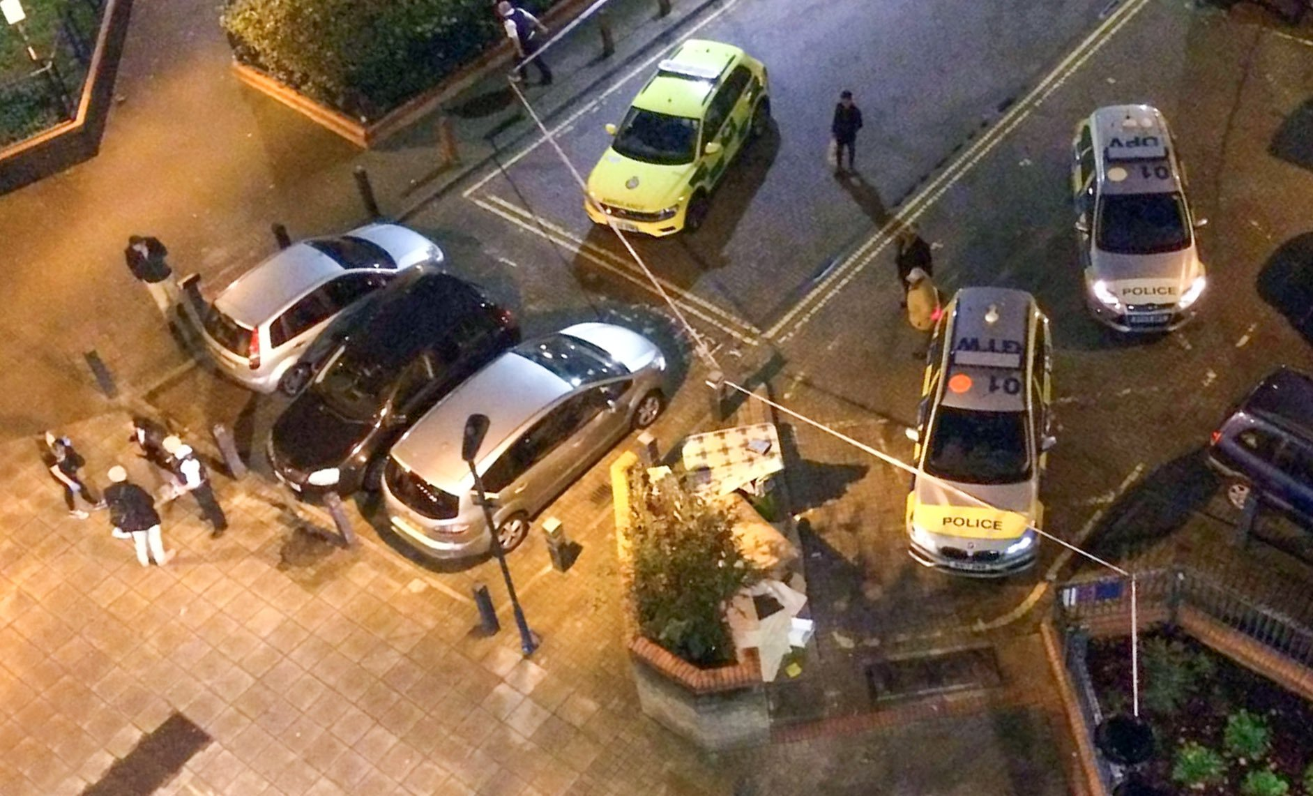 "Police at the scene at the Doddington Estate in Battersea, London. Ian Tomlin. 46, was killed. October 17 2018.. See story NNmurder. A ?devoted? dad-of-two died trying to protect his young children from anti-social drug dealers in his block of flats.Ian Tomlin, 46, was described as the ?loveliest, kindest guy? by a neighbour in his estate today (thur). The woman wished not to be named over fear of reprisals from his killers but added: ""He was a devoted dad. ""Ian was very against the drug dealers right where he was murdered on that first floor landing and especially the antisocial behaviour when he had his children with him - noise up to four of five in the morning."