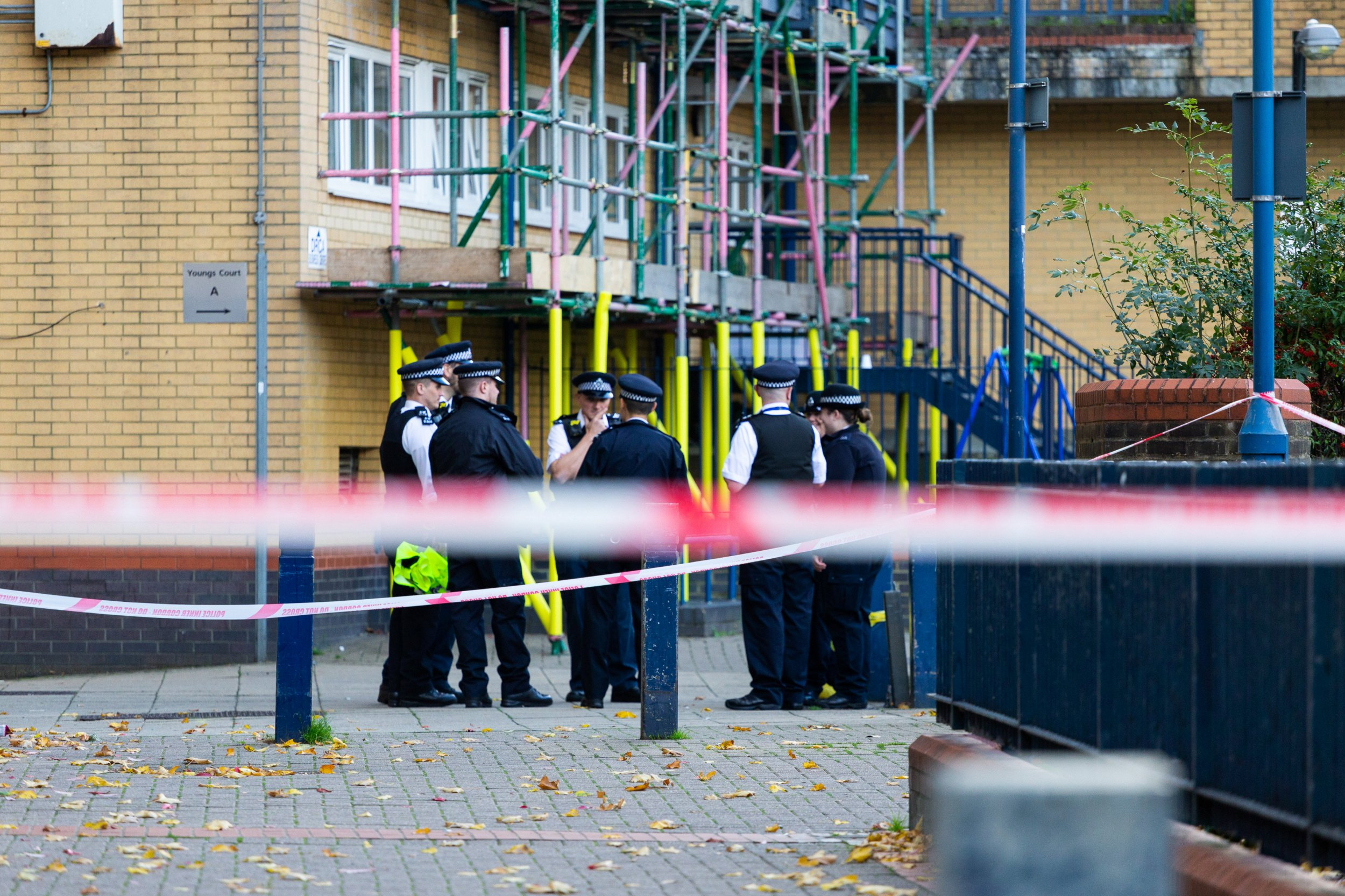 """A large police cordon remains in place following the murder on October 17th of Ian Tomlin, 46, at the high-rise Doddington Estate in Battersea, South London . Battersea, London, October 18 2018. See story NNmurder4. A ?devoted? dad-of-two died trying to protect his young children from anti-social drug dealers in his block of flats.Ian Tomlin, 46, was described as the ?loveliest, kindest guy? by a neighbour in his estate today (thur). The woman wished not to be named over fear of reprisals from his killers but added: """"He was a devoted dad. """"Ian was very against the drug dealers right where he was murdered on that first floor landing and especially the antisocial behaviour when he had his children with him - noise up to four of five in the morning."""