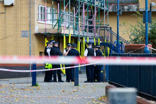 "A large police cordon remains in place following the murder on October 17th of Ian Tomlin, 46, at the high-rise Doddington Estate in Battersea, South London . Battersea, London, October 18 2018. See story NNmurder4. A ?devoted? dad-of-two died trying to protect his young children from anti-social drug dealers in his block of flats.Ian Tomlin, 46, was described as the ?loveliest, kindest guy? by a neighbour in his estate today (thur). The woman wished not to be named over fear of reprisals from his killers but added: ""He was a devoted dad. ""Ian was very against the drug dealers right where he was murdered on that first floor landing and especially the antisocial behaviour when he had his children with him - noise up to four of five in the morning."