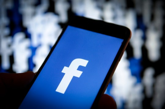 A Facebook logo is seen on an iPhone screen in this photo illustration on November 20, 2017. (Photo by Jaap Arriens/NurPhoto via Getty Images)