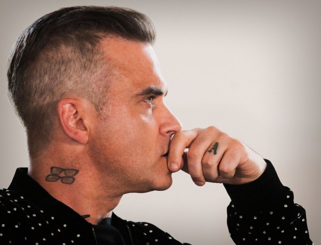 Mandatory Credit: Photo by James Shaw/REX/Shutterstock (9764295d) Robbie Williams 'The X Factor' TV show launch, London, UK - 17 Jul 2018