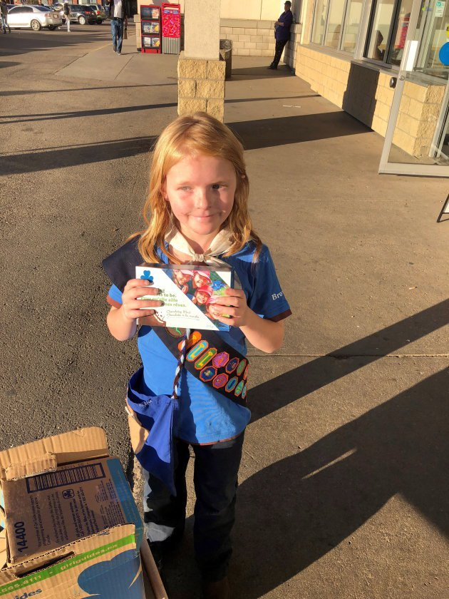 Nine-year-old Elina Childs poses as she sells Girl Guide Cookies outside a cannabis store in Edmonton on Wednesday, Oct. 17, 2018 in this handout photo. She's being called one smart cookie. As people lined up to buy marijuana at one of six Edmonton cannabis stores that opened Wednesday, there was a small entrepreneur in the crowd. Nine-year-old Elina Childs had a wagon full of Girl Guide cookies for sale. Family Handout - Seann Childs