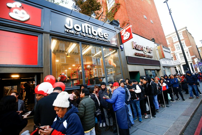 People queue ahead of the opening of the first Jollibee restaurant to open in the UK, in London, Britain October 20, 2018. REUTERS/Henry Nicholls