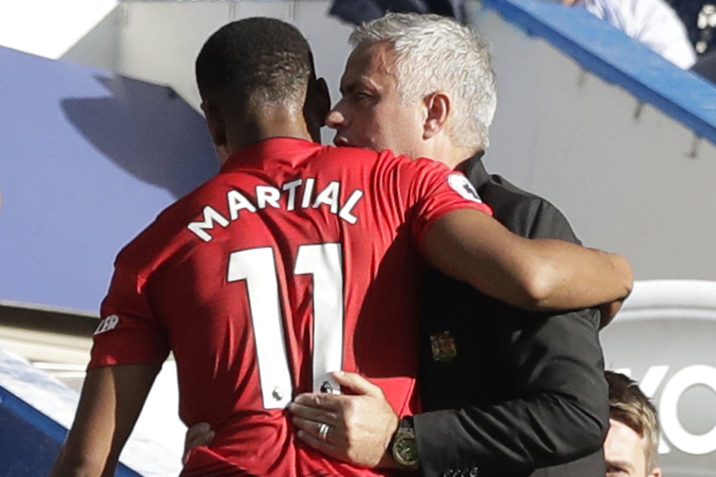 ManU coach Jose Mourinho hugs Anthony Martial who scored two goals after taking him off for a substitute during their English Premier League soccer match between Chelsea and Manchester United at Stamford Bridge stadium in London Saturday, Oct. 20, 2018. (AP Photo/Matt Dunham)