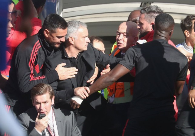 LONDON, ENGLAND - OCTOBER 20: Manager Jose Mourinho of Manchester United clashes with a member of the Chelsea backroom staff during the Premier League match between Chelsea FC and Manchester United at Stamford Bridge on October 20, 2018 in London, United Kingdom. (Photo by John Peters/Man Utd via Getty Images)
