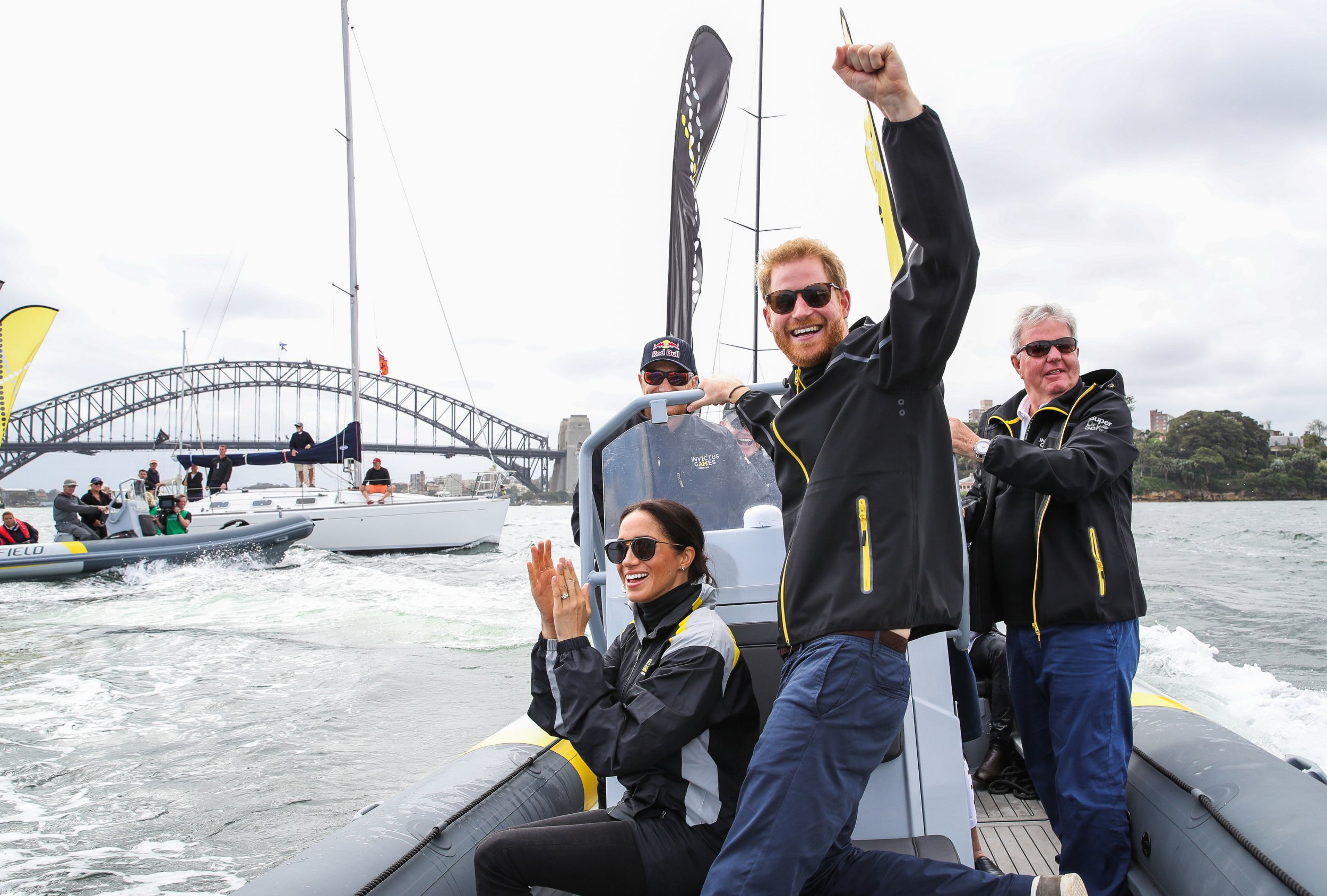 The Duke and Duchess of Sussex cheer on competitors taking part in a sailing event at the 2018 Invictus Games in Sydney harbour. PRESS ASSOCIATION Photo. Picture date: Sunday October 21, 2018. See PA story ROYAL Tour. Photo credit should read: Chris Jackson/Invictus Games Foundation/PA Wire