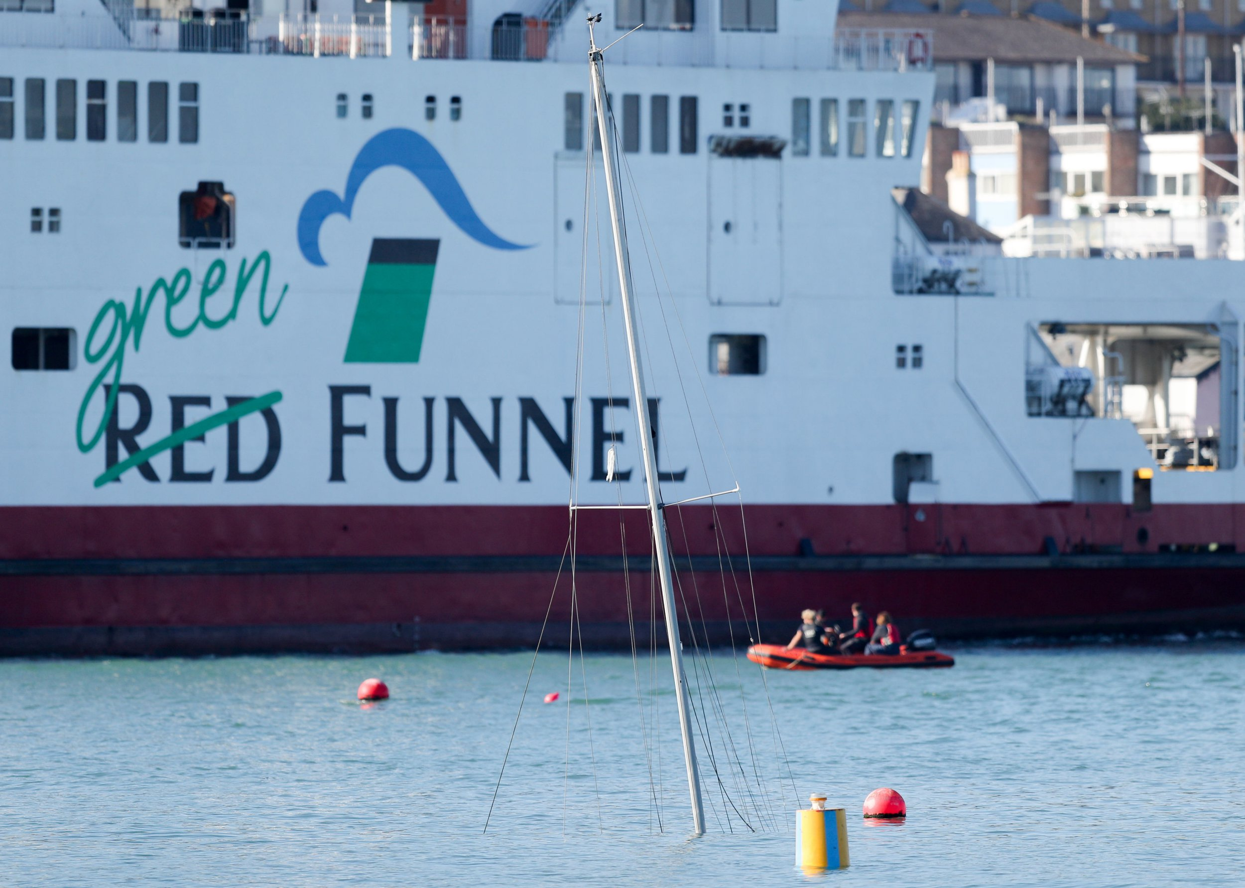 The Red Funnel car ferry, Red Falcon, which earlier collided with several small boats due to bad weather, passes the mast of a submerged yacht as she leaves East Cowes on the Isle of Wight bound for Southampton. PRESS ASSOCIATION Photo. Picture date: Sunday October 21, 2018. See PA story ACCIDENT Ferry. Photo credit should read: Andrew Matthews/PA Wire