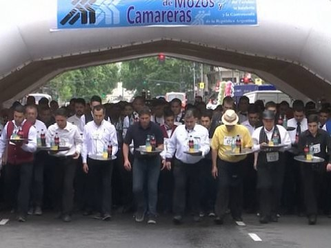 Hundreds of waiters try not to spill any drinks in street race