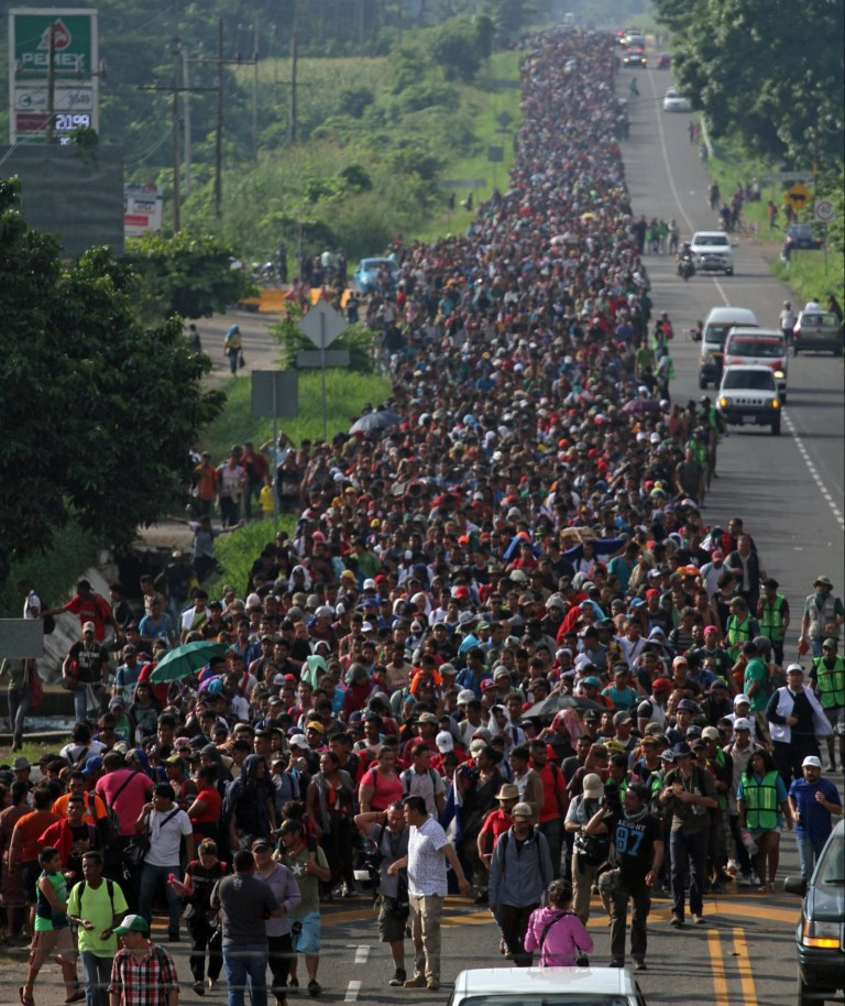 epa07110029 Honduran migrants continue their way to the city of Tapachula, Mexico, 21 October 2018 According to sources of Civil Protection of Mexico, there are more than 3,000 migrants who travel the almost 40 kilometers between Ciudad Hidalgo and Tapachula, the second most important city in the Mexican state of Chiapas, where they have announced that they will spend the night. EPA/Maria de la Luz Ascencio