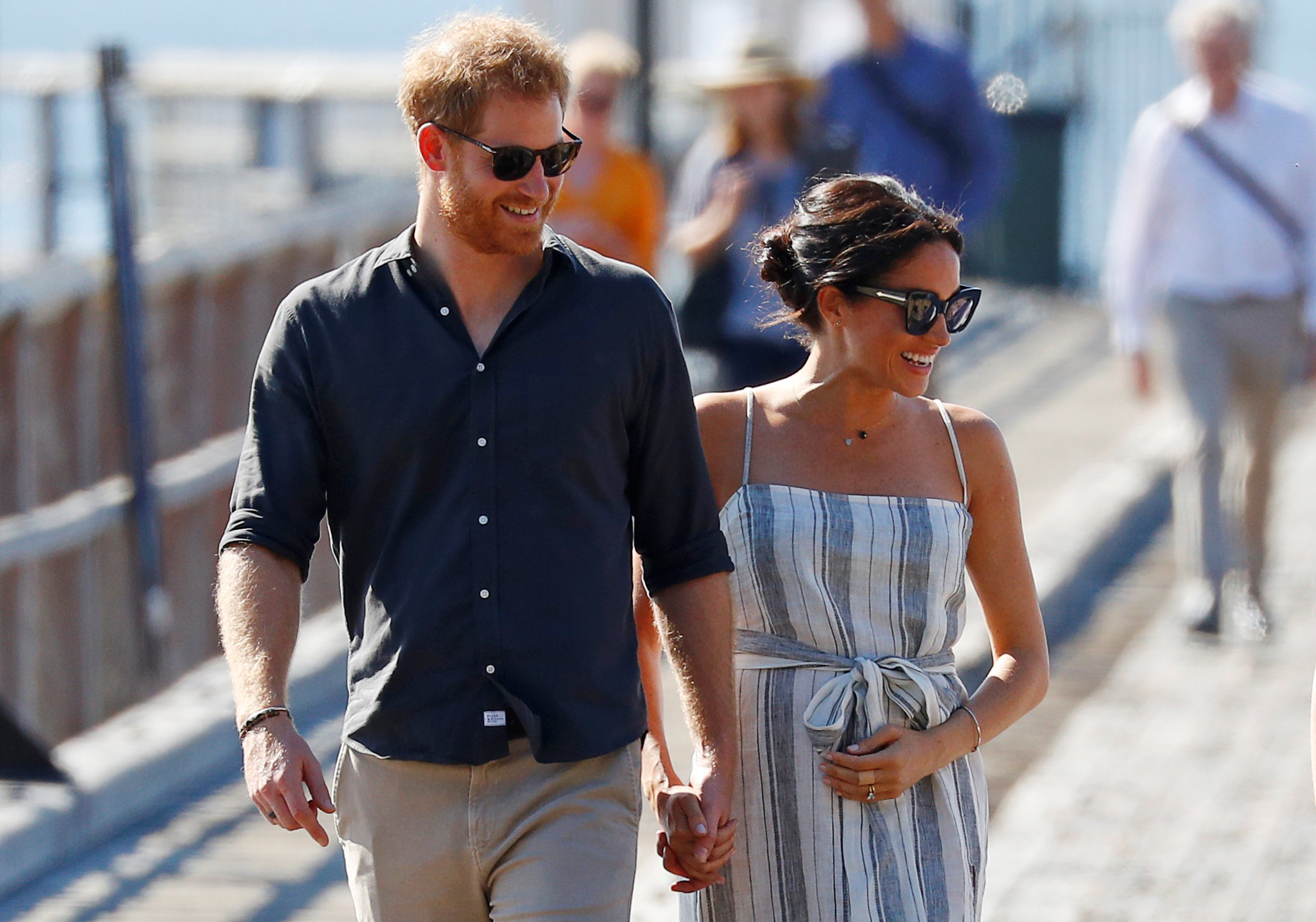 Britain's Prince Harry and Meghan, Duchess of Sussex, arrive to greet members of the public in Kingfisher Bay on Fraser Island in Queensland, Australia October 22, 2018. REUTERS/Phil Noble