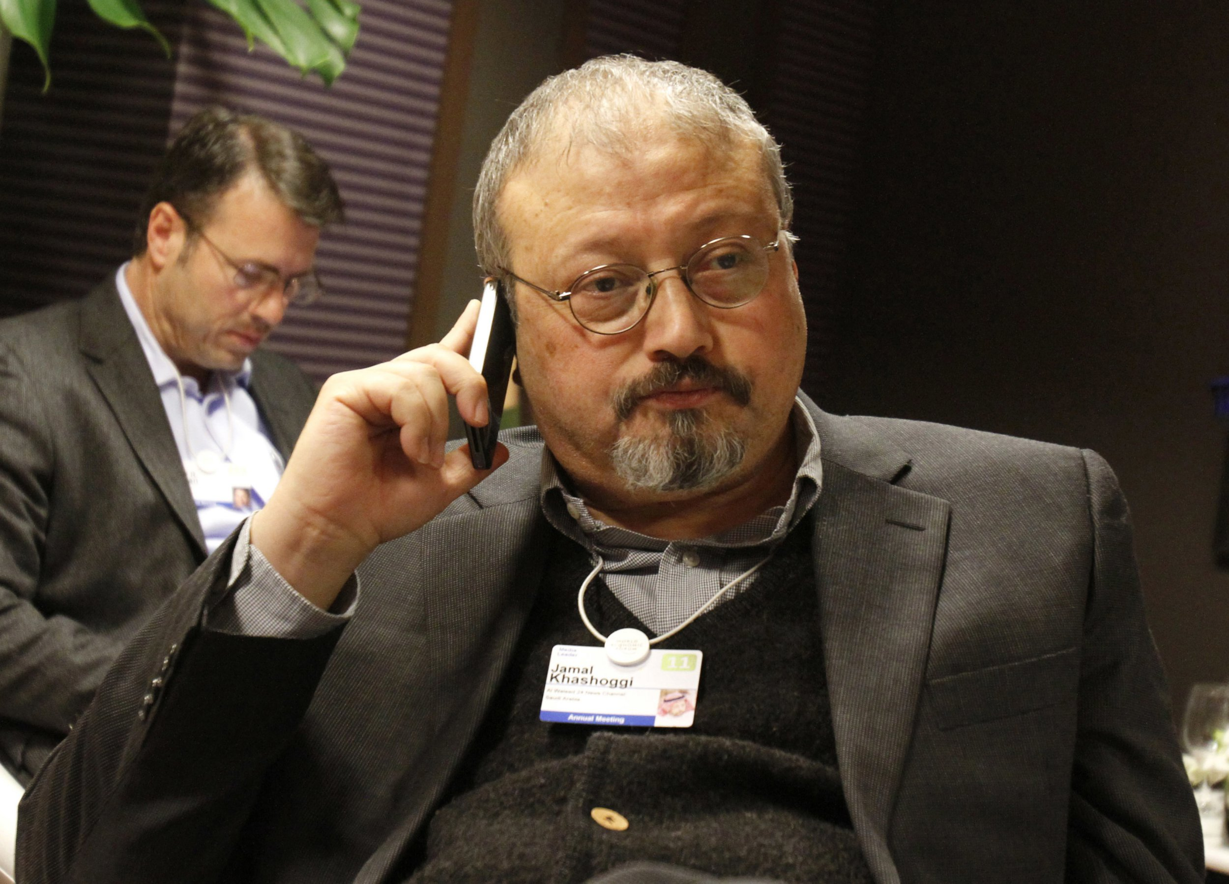 FILE - In this Jan. 29, 2011, file photo, Saudi Arabian journalist Jamal Khashoggi speaks on his cellphone at the World Economic Forum in Davos, Switzerland. In recent months, the Trump administration has repeatedly put off the release of its long-awaited Mideast peace plan. Now, the death of Saudi journalist Jamal Khashoggi at the hands of Saudi agents may put the plan into a deep freeze. (AP Photo/Virginia Mayo, File)