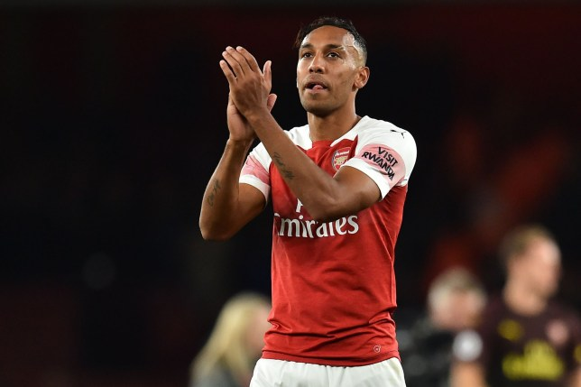 Arsenal's Gabonese striker Pierre-Emerick Aubameyang applauds supporters on the pitch after the English Premier League football match between Arsenal and Leicester City at the Emirates Stadium in London on October 22, 2018. - Arsenal won the game 3-1. (Photo by Glyn KIRK / IKIMAGES / AFP) / RESTRICTED TO EDITORIAL USE. No use with unauthorized audio, video, data, fixture lists, club/league logos or 'live' services. Online in-match use limited to 45 images, no video emulation. No use in betting, games or single club/league/player publications.GLYN KIRK/AFP/Getty Images