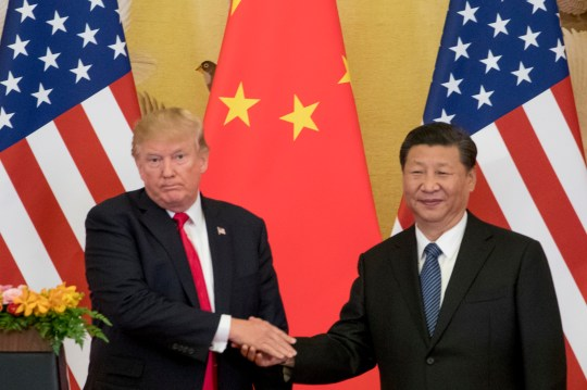 FILE - In this Nov. 9, 2017 file photo, President Donald Trump and Chinese President Xi Jinping shake hands during a joint statement to members of the media Great Hall of the People in Beijing, China. The White House???s move to expand Washington???s dispute with Beijing beyond trade and technology and into accusations of political meddling have sunk relations between the world???s two largest economies to their lowest level since the end of the Cold War. (AP Photo/Andrew Harnik, File)