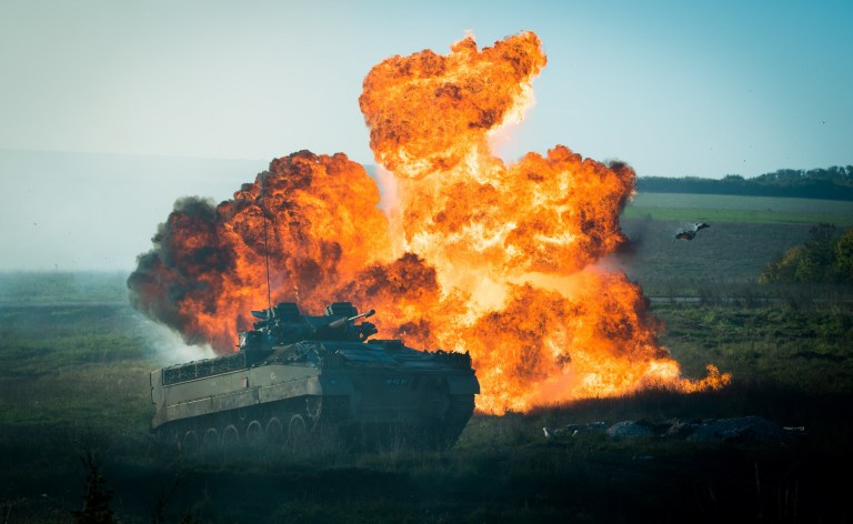 20181022 Copyright image 2018? A Warrior armoured infantry vehicle in action on Salisbury Plain on Monday 22 October 2018 during the Army's Land Combat Power 2018 four day demonstration showcasing the force's scientific and technological capabilities. For photographic enquiries please call Fiona Hanson 07710 142 633 or email info@fionahanson.com This image is copyright Fiona Hanson 2018?. This image has been supplied by Fiona Hanson and must be credited Fiona Hanson. The author is asserting her full Moral rights in relation to the publication of this image. All rights reserved. Rights for onward transmission of any image or file is not granted or implied. Changing or deleting Copyright information is illegal as specified in the Copyright, Design and Patents Act 1988. If you are in any way unsure of your right to publish this image please contact Fiona Hanson on07710 142 633 or email info@fionahanson.com
