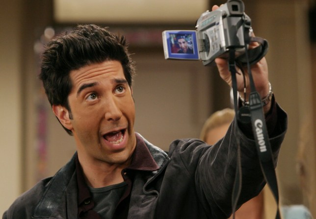 """BURBANK, CA - SEPTEMBER 12: (EXCLUSIVE, NO U.S. TABLOID SALES) David Schwimmer, who plays Ross on the hit NBC series """"Friends,"""" performs during one of their last shows on the Warner Bros lot Sept. 12, 2003 in Burbank, CA. """"Friends,"""" which is in its ninth and final season, debuted in 1994, has won 44 Emmys, and is one of the biggest successes in television history. (Photo by David Hume Kennerly/Getty Images) This image is not included in any subscription deal. Use of this image will incur a charge."""