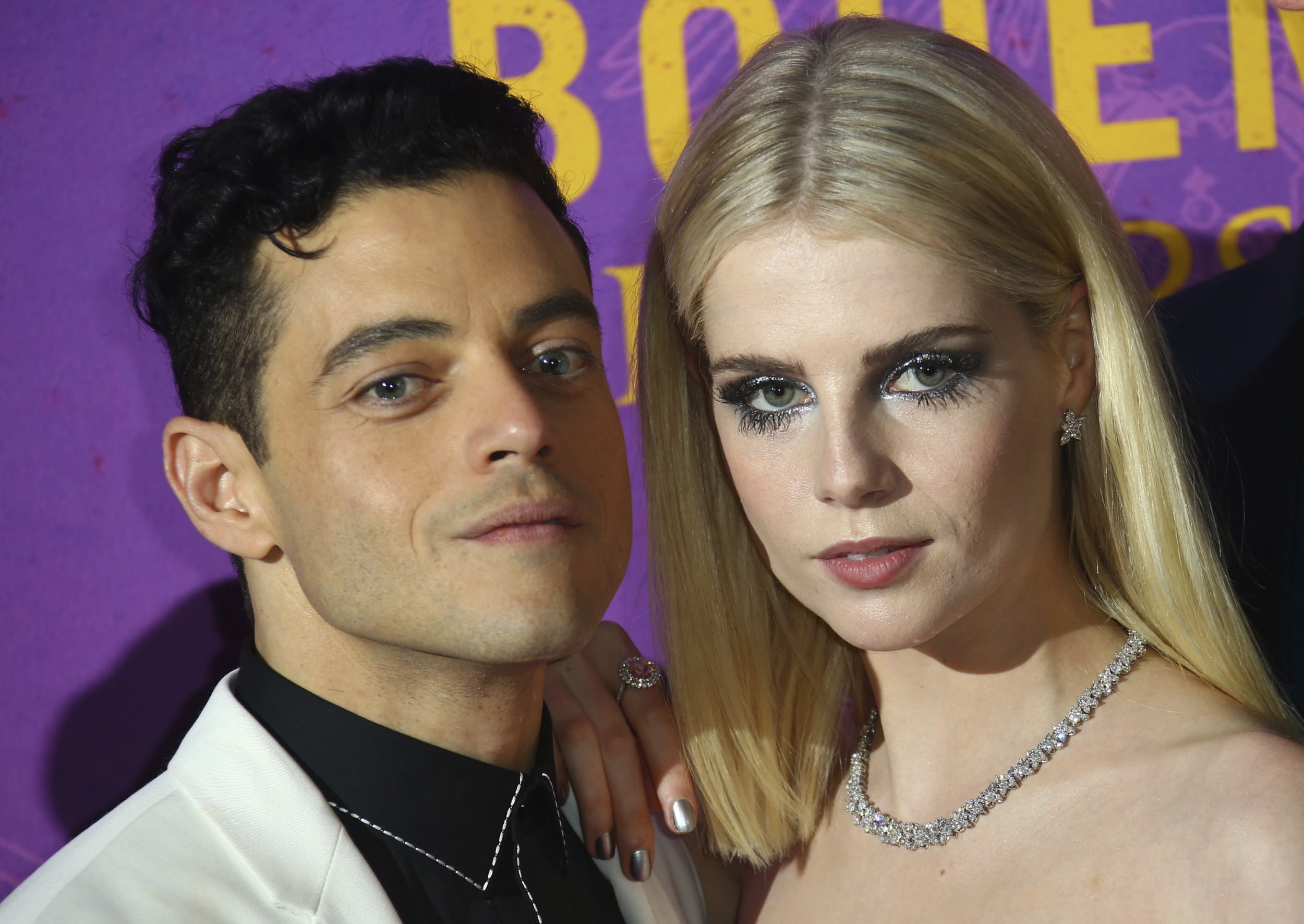 Actors Rami Malek, left, and Lucy Boynton pose for photographers upon arrival at the World premiere of the film 'Bohemian Rhapsody' in London Tuesday, Oct. 23, 2018. (Photo by Joel C Ryan/Invision/AP)