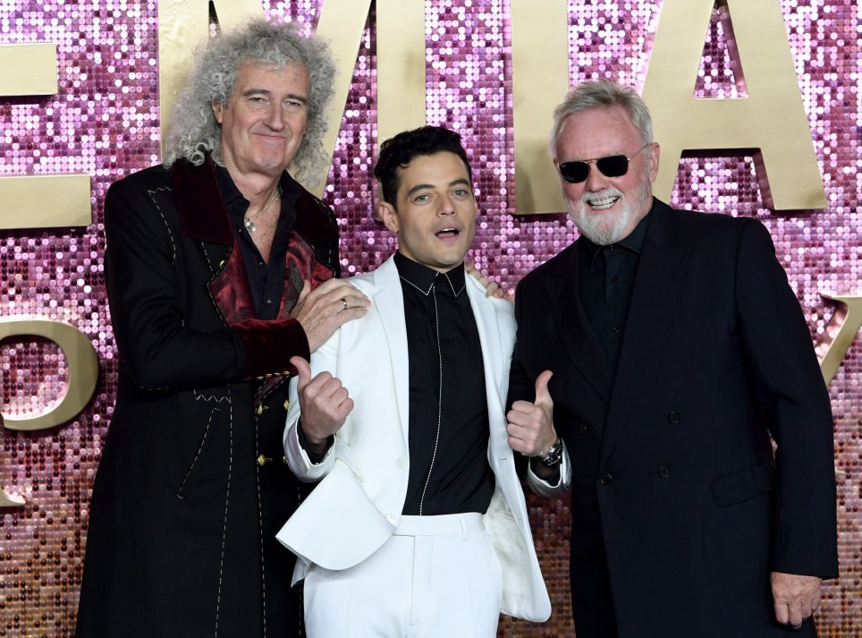 epa07114683 US actor and cast member Rami Malek (C) who plays the role of Freddie Mercury, poses with members of British rock band 'Queen' Roger Taylor (R) and Brian May (L) attend the world premiere of 'Bohemian Rhapsody' in London, Britain, 23 October 2018. The movie opens across UK theaters on 24 October. EPA/FACUNDO ARRIZABALAGA