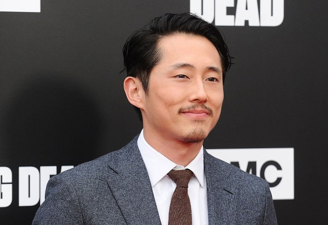 "HOLLYWOOD, CA - OCTOBER 23: Actor Steven Yeun attends the live, 90-minute special edition of ""Talking Dead"" at Hollywood Forever on October 23, 2016 in Hollywood, California. (Photo by Jason LaVeris/FilmMagic)"