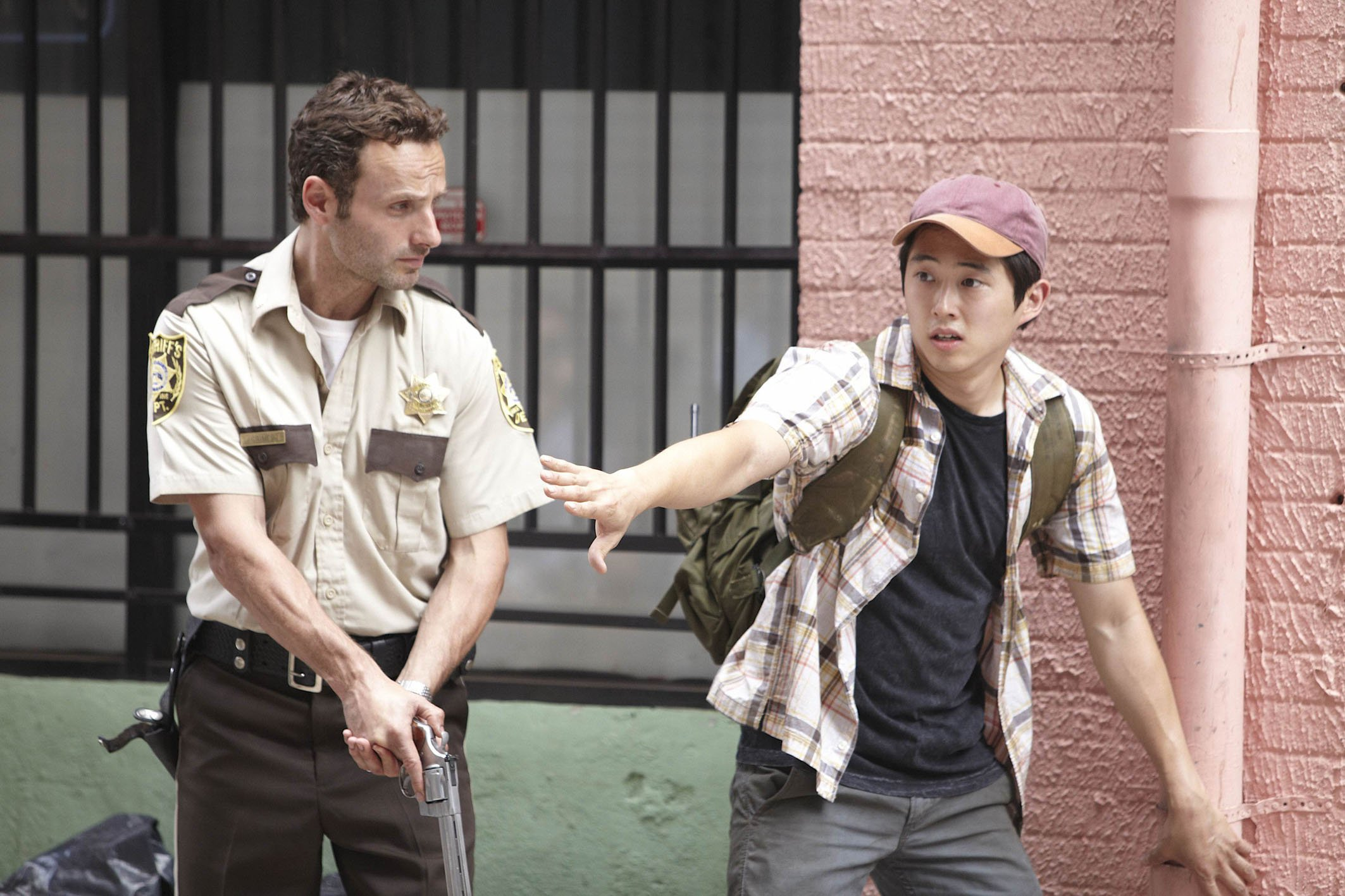 Television programme: The Walking Dead Episode 1.3 Tell It To The Frogs Andrew Lincoln as Rick Grimes and Steven Yeun as Glenn