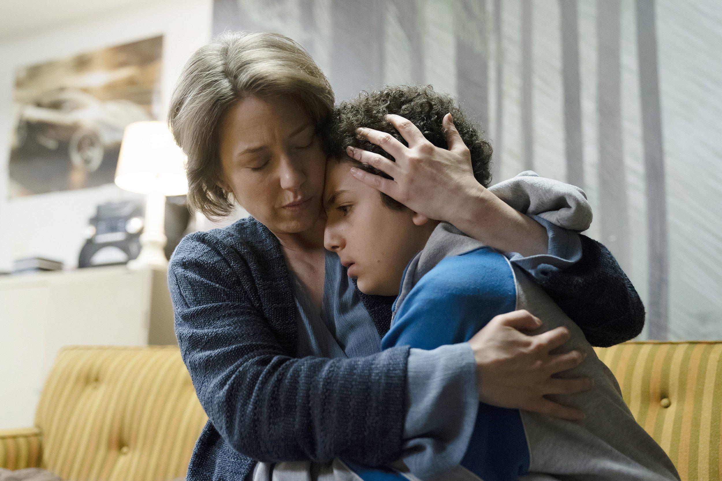 "THE SINNER -- ""Part II"" Episode 202 -- Pictured: (l-r) Carrie Coon as Vera Walker, Elisha Henig as Julian Walker -- (Photo by: Peter Kramer/USA Network)"