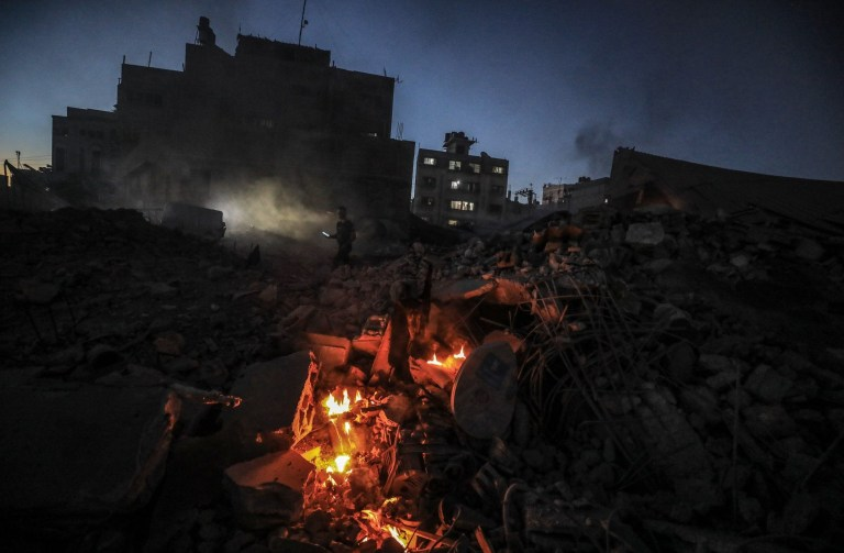 GAZA CITY, GAZA - OCTOBER 27: Smoke and flames rise after an Israeli airstrike hit a five-storey building in the Gaza Strip in response to rockets said were fired towards the country, in southern Gaza City, Gaza on October 27, 2018. Fighter jets and helicopters pounded targets in Gaza for more than two hours, including Hamas sites, the Israeli army said in a press release. (Photo by Ali Jadallah/Anadolu Agency/Getty Images)