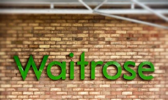 BRISTOL, ENGLAND - NOVEMBER 18: (EDITORS NOTE: This image was created using digital filters) The Waitrose sign is displayed outside a branch of the supermarket on November 18, 2015 in Bristol, England. As the crucial Christmas retail period approaches, all the major supermarkets are becoming increasingly competitive to retain and increase their share of the market. (Photo by Matt Cardy/Getty Images)
