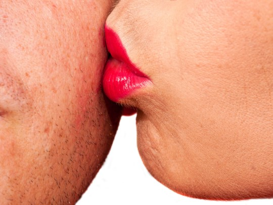 Woman with red lips kissing man's cheek; Shutterstock ID 95545888; Purchase Order: -