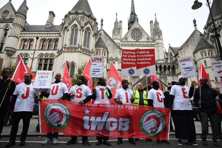 Uber drivers stage a protest outside the Royal Courts of Justice, London, before a ruling on their employment rights. PRESS ASSOCIATION Photo. Picture date: Tuesday October 30, 2018. See PA story COURTS Uber. Photo credit should read: Stefan Rousseau/PA Wire