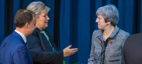 Lithuania's Health Minister, Aurelijus Veryga (L) talks with British PM Theresa May and Norwegian Prime Minister Erna Solberg (C) during the opening session of Northern Future Forum aiming at discussing the role of health technology in the future healthcare system on October 30, 2018 at the Oslo Cancer Cluster in Oslo. (Photo by Heiko JUNGE / NTB scanpix / AFP) / Norway OUTHEIKO JUNGE/AFP/Getty Images
