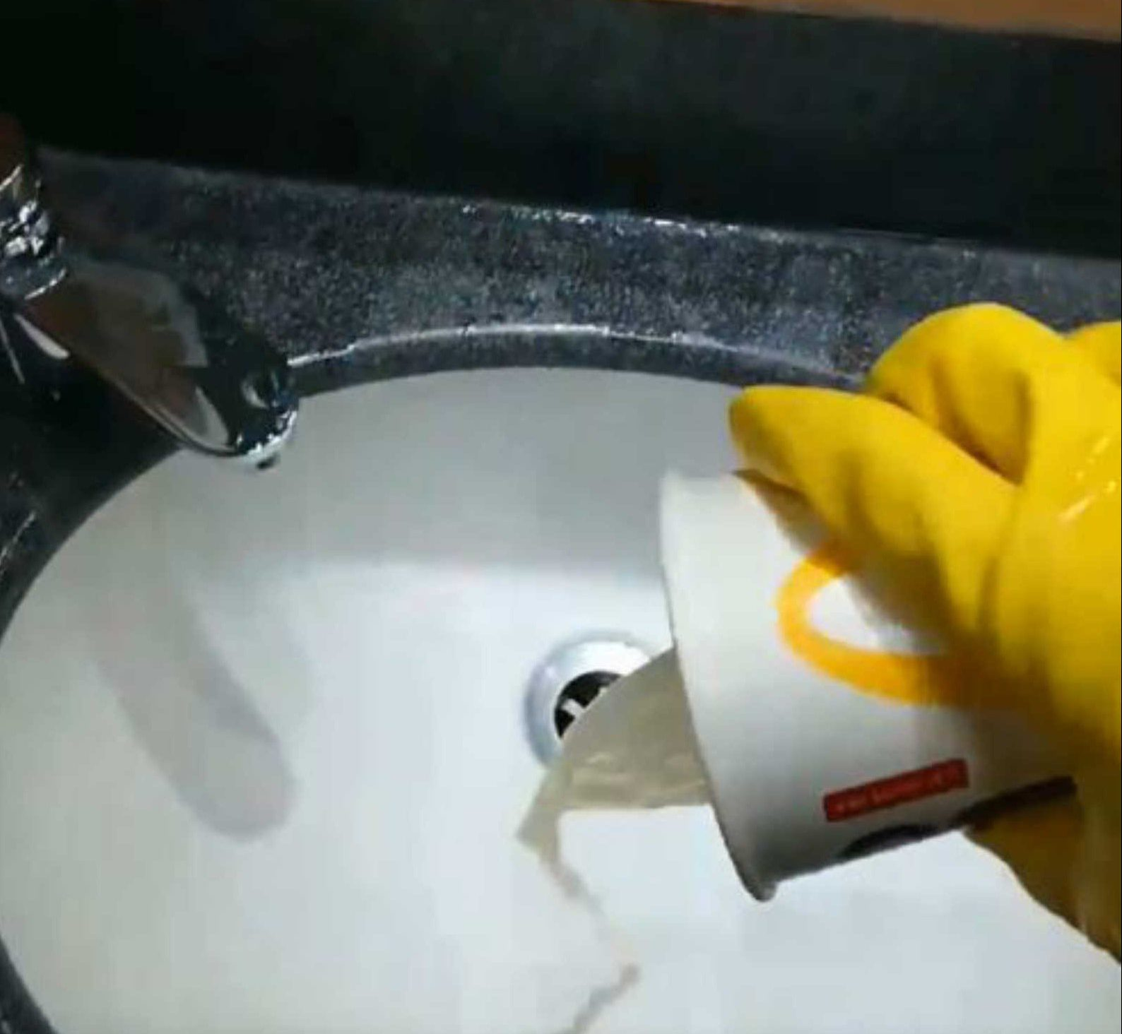 DISGUSTING footage shows how a McDonald?s employee was instructed to scoop urine out of a blocked urinal with a paper cup. Kayleigh Greatorex filmed herself as she filled the McDonald's cup and then emptied the contents in the sink inside the customer toilets. McDonald's today admitted that the stomach-churning incident at one of their London stores breached policy as was being investigated. Mum-of-one Kayleigh, 20, said the incident happened while she was working at the Tower Retail Park in Crayford, Bexley, last year. Kayleigh, who resigned shortly afterwards, said she was specifically told to empty the cup into the sink. The short video shows her wearing yellow rubber gloves and holding a McDonald?s cup. She is then seen scooping the contents of the obviously blocked urinal into the cup. She then turns and empties the contents into a sink behind.