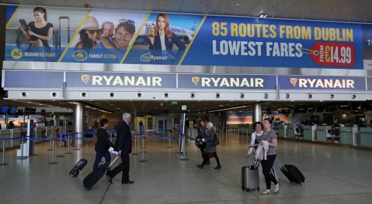 File photo dated 21/09/17 of passengers underneath Ryanair signage, as new rules implemented by the airline means passengers are no longer able to take two cabin bags on board flights free of charge.
