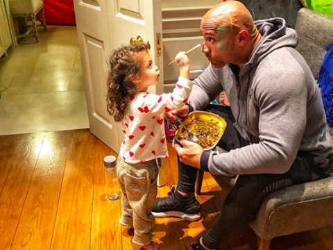 Dwayne Johnson lets his daughter paint his face before work because he 'can't say no' to his beautiful little girl