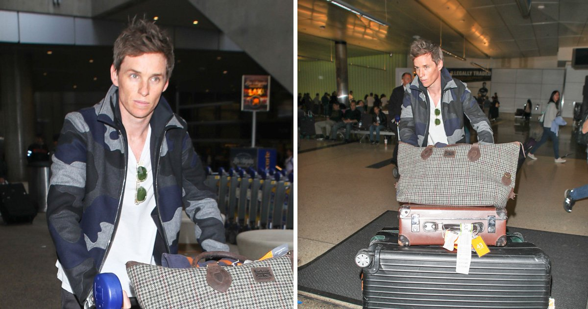 Eddie Redmayne might need a lesson in packing light as he jets into LA solo with five bags