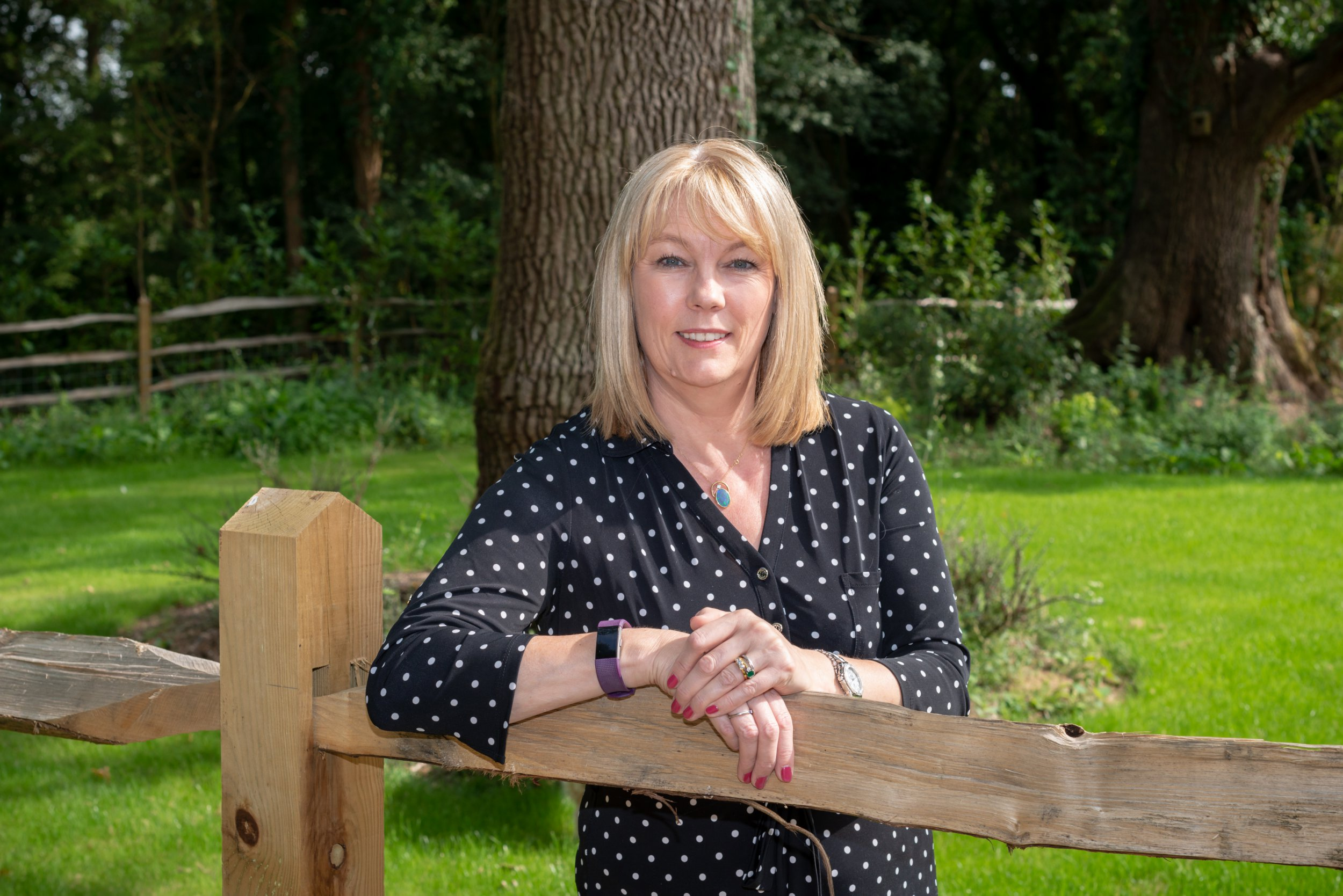 Wisborough Green, West Sussex, UK. 24th August 2018. Ali Stunt, CEO of the Pancreatic Cancer Action charity, at her home in Wisborough Green, West Sussex. In Photo: Ali Stunt in her garden.