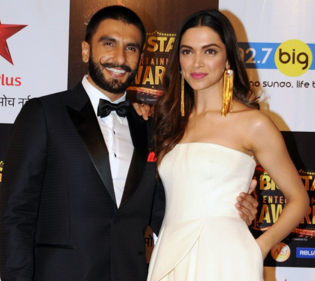 (FILES) In this file photo taken on December 13, 2015 Indian Bollywood actors Ranveer Singh (L) and Deepika Padukone attend the BIG Star Entertainment Awards 2015 ceremony in Mumbai. - Bollywood superstars Deepika Padukone and Ranveer Singh announced on October 21 that they are tying the knot, ending months of speculation about their relationship. The pair confirmed they will be married next month in a statement posted on their official Twitter accounts in Hindi and English. (Photo by - / AFP)-/AFP/Getty Images