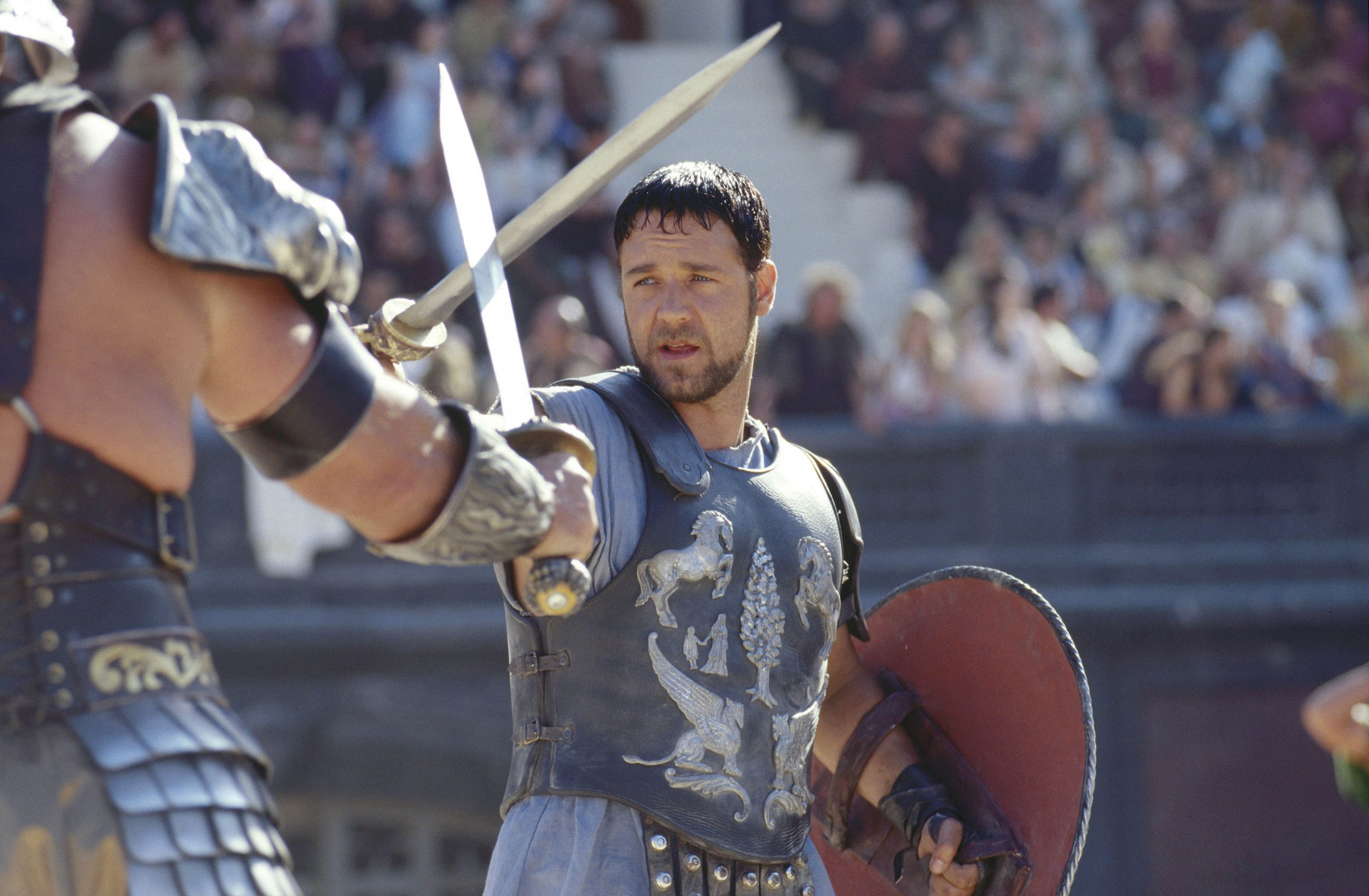 Editorial use only. No book cover usage. Mandatory Credit: Photo by Jaap Buitendijk/Dreamworks/Universal/Kobal/REX/Shutterstock (5885504i) Russell Crowe Gladiator - 2000 Director: Ridley Scott Dreamworks/Universal USA Scene Still