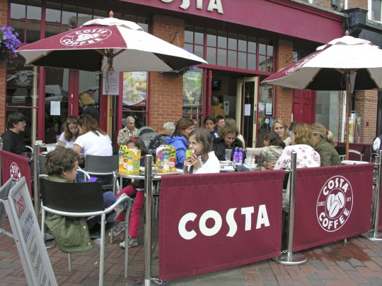 Mandatory Credit: Photo by Photofusion/REX/Shutterstock (2269099a) Costa Coffee chain - people sitting outside in shopping precinct area Food & Drink
