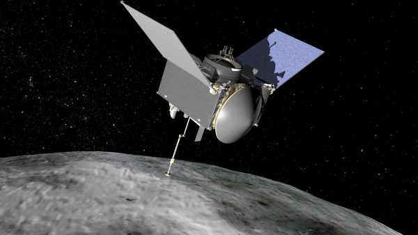 This artist?s conception shows the OSIRIS-REx spacecraft extending its sampling arm as it moves in to make contact with the asteroid Bennu. Credits: NASA/GSFC