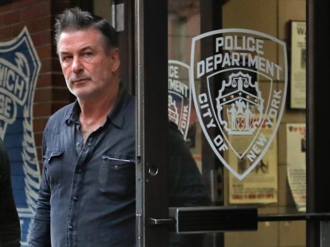 Alec Baldwin looks less than impressed as he's charged with assault following road rage incident