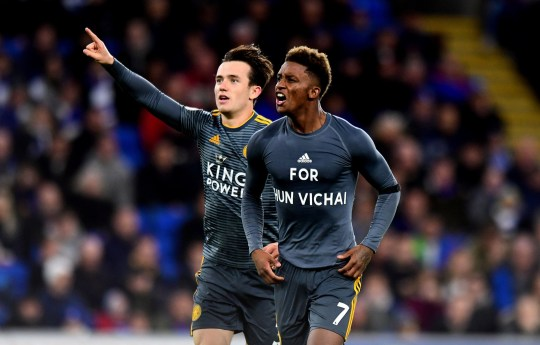 """Leicester City's Demarai Gray celebrates scoring his side's first goal of the game and reveals a shirt that reads 'For Khun Vichai' during the Premier League match at the Cardiff City Stadium, Cardiff. PRESS ASSOCIATION Photo. Picture date: Saturday November 3, 2018. See PA story SOCCER Cardiff. Photo credit should read: Simon Galloway/PA Wire. RESTRICTIONS: EDITORIAL USE ONLY No use with unauthorised audio, video, data, fixture lists, club/league logos or """"live"""" services. Online in-match use limited to 120 images, no video emulation. No use in betting, games or single club/league/player publications."""