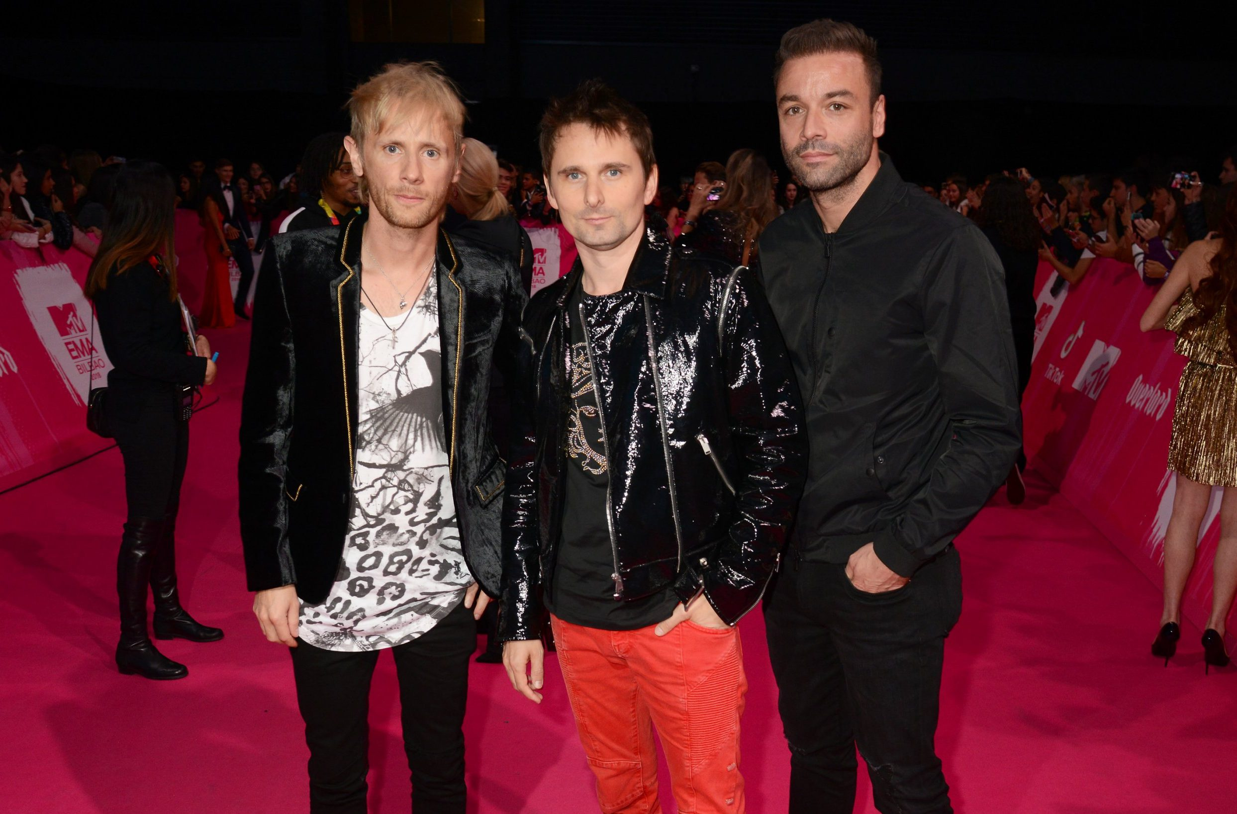 BILBAO, SPAIN - NOVEMBER 04: (L-R) Dominic Howard, Matt Bellamy and Chris Wolstenholme of Muse attend the MTV EMAs 2018 at the Bilbao Exhibition Centre (BEC) on November 04, 2018 in Bilbao, Spain. (Photo by Dave J Hogan/Dave J Hogan/Getty Images for MTV)