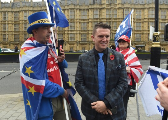 epa07145263 Far right activist, known as Tommy Robinson, (Stephen Christopher Yaxley-Lennon) walks past anti Brexit protesters outside the British Houses of Parliament in central London, Britain, 06 November 2018. EPA/FACUNDO ARRIZABALAGA